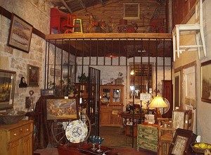 JAIL TIME: Though it once housed the infamous Marlowe Brothers, the Young County jail is now an antique shop. (Terri Hirsch)