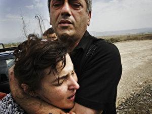 Verzweifelter Flüchtling aus Gori während ihrer Flucht aus dem umkämpften Grenzgebiet Südossetiens. (AFP Photo/Marco Longari)