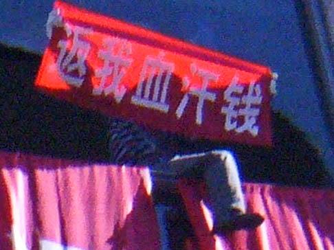 Betrogene Aktionäre protestieren in Peking