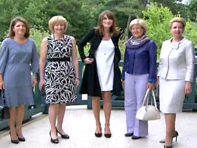 French First Lady Carla Bruni-Sarkozy Greets G8 Spouses