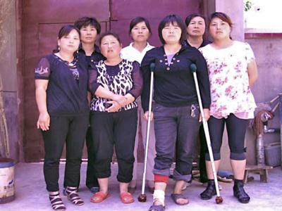 Chinesischer Internet-Blog: Frauen von Sicherheitskräften ausgezogen und geschlagen