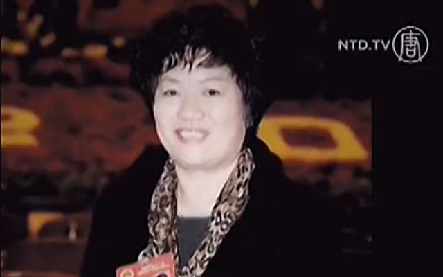 Gong Aiai, eine Bankangestellte aus Shaanxi, China.   Foto: NTD Television