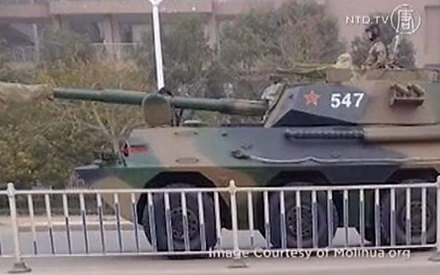 Panzer aus China auf dem Weg zu Gebieten nahe der Senkaku Inseln.   Foto: NTD Television