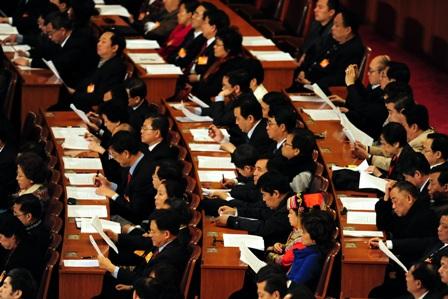 China: Beamte fressen dem Staat die Haare vom Kopf