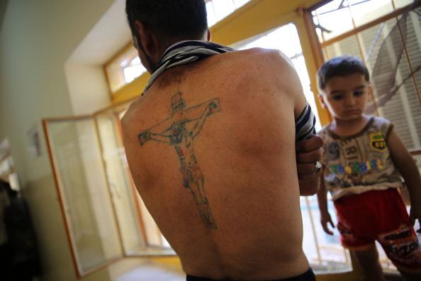 Foto aus dem Irak: Dieser Mann mit Jesus-Tattoo floh im Juni 2014 vor dem ISIS-Vormarsch. Foto: Spencer Platt/Getty Images