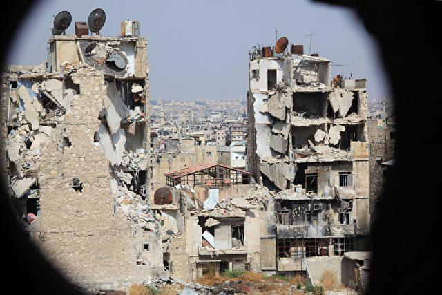 Beschädigte Gebäude in Aleppo. Foto: GEORGE OURFALIAN / AFP / Getty Images