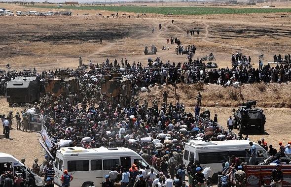 Flüchtlinge an der syrischen Grenze Foto: STR/Getty Images