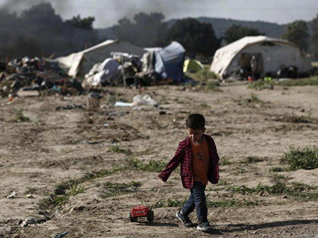 Ein Junge aus Syrien während der Räumung des Lagers beiIdomeni in der vergangenenWoche.Foto: Yannis Kolesidis/dpa