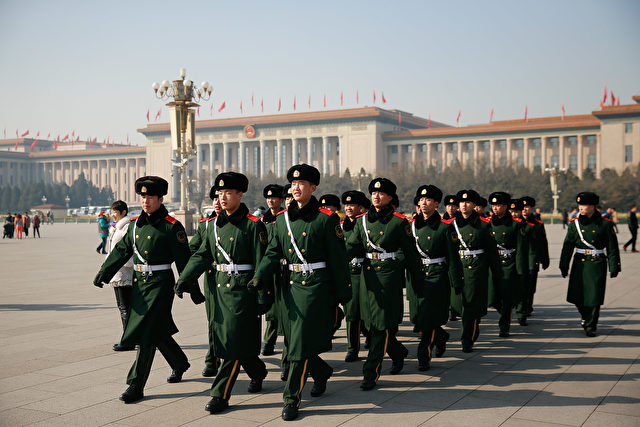 BEIJING, CHINA - MARCH 02: Chinese paramilitary police officers patrol Tiananmen Square on March 2, 2015 in Beijing, China. The Third Session of the 12th National People's Congress (NPC) and the Third Session of the 12th Chinese People's Political Consultative Conference (CPPCC) will be held on March 5 and March 3 in Beijing.  (Photo by Lintao Zhang/Getty Images)