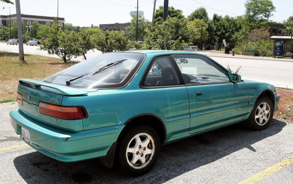 MORTON GROVE, IL - JULY 19:  An older-model Acura Integra is seen in a parking lot July 19, 2005 in Morton Grove, Illinois. Acura's Integra toped the most stolen car list of 2004. (Photo by Tim Boyle/Getty Images)