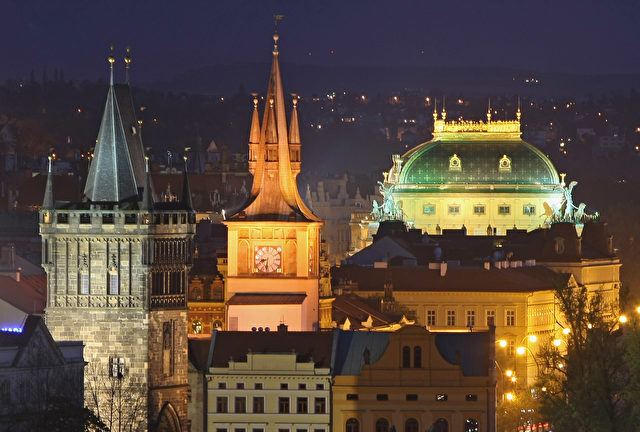 PRAGUE, CZECH REPUBLIC - APRIL 12: Lights illuminate buildings in Old Town, including one of the Charles Bridge towers (L) and the National Theatre (R), on April 12, 2009 in Prague, Czech Republic. Prague is among Europe's major tourist destinations.  (Photo by Sean Gallup/Getty Images)