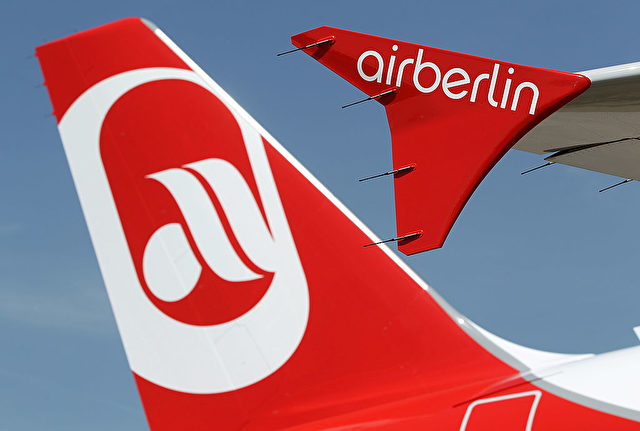 BERLIN - JUNE 09:  The logo of discount airline Air Berlin is displayed on an Air Berlin passenger plane at Schoenefeld Airport during the ILA Berlin Air Show on June 9, 2010 in Berlin, Germany. The German government recently announced that it will impose a flight-departure tax as part of a financial austerity package aimed at cutting the federal budget by EUR 80 billion by 2014. Many airlines have already protested against the proposed measure, citing the hit they've already taken from flight cancellations due to Iceland's volcano.  (Photo by Sean Gallup/Getty Images)