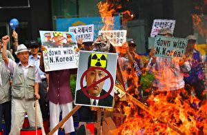 "South Korean conservative activists set fire to a portrait of North Korean leader Kim Jong-Un during a protest denouncing North Korea's nuclear test in Seoul on September 10, 2016. South Korean newspapers sounded the alarm on September 10 over what one termed the ""nuclear maniac"" Kim Jong-Un, saying the North Korean leader's fifth and biggest nuclear test is a game-changer demanding a tougher response. / AFP / JUNG YEON-JE (Photo credit should read JUNG YEON-JE/AFP/Getty Images)"