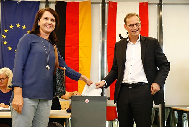 Berlin's mayor Michael Mueller, top candidate of the social democratic SPD party, and his wife Claudia cast their ballots at a polling station in Berlin during a regional election on September 18, 2016 in Berlin. Some 2.5 million eligible voters in Berlin will choose both a new city-state parliament and 12 local district assemblies. / AFP / Odd ANDERSEN (Photo credit should read ODD ANDERSEN/AFP/Getty Images)