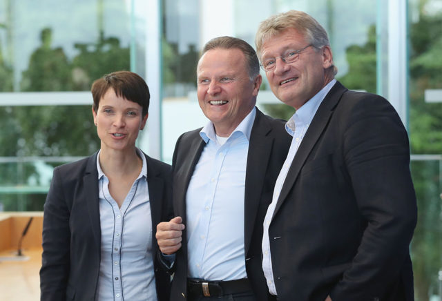 BERLIN, GERMANY - SEPTEMBER 19:  Frauke Petry (L) and Joerg Meuthen (R), co-heads of the Alternative fuer Deutschland (AfD) political party, arrive with AfD Berlin candidate Georg Pazderski to speak to the media the day after Berlin state elections on September 19, 2016 in Berlin, Germany. The city of Berlin, which is one of Germany's 16 states, or Bundeslaender, held elections yesterday for its state parliament and the German Christian Democrats (CDU), the party of German Chancellor Angela Merkel, finished with 17.6% of the vote, its worst result ever. Merkel has faced a string of poor state election results this year that critics charge is due in part to her liberal policy towards refugees and migrants. Meanwhile the upstart right-wing populist AfD has gained seats in state parliaments across the country and in Berlin landed 14.2% of the vote.  (Photo by Sean Gallup/Getty Images)