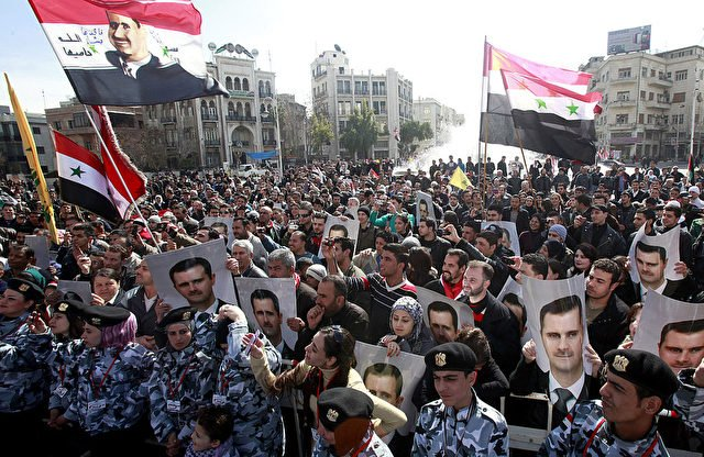 Syrian supporters of President Bashar al
