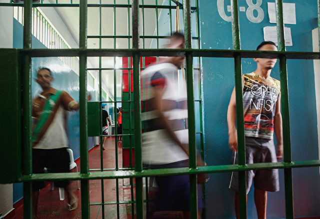 MANAUS, BRAZIL - FEBRUARY 18:  Inmates gather in the overcrowded Puraquequara prison on February 18, 2016 in Manaus, Brazil. The prison holds nearly 1,400 inmates, around twice as many as it was designed for. Brazil now holds the fourth-largest prison population in the world, behind the U.S., Russia and China, with the number of Brazilians behind bars nearly doubling in the past decade. The prison system currently holds more than 600,000 inmates, 61 percent over capacity, according to Human Rights Watch.  (Photo by Mario Tama/Getty Images)