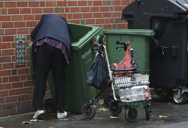 BERLIN, GERMANY - OCTOBER 06:  An elderly woman picks out discarded grocery items from a recycling bin behind a supermarket on October 6, 2016 in Berlin, Germany. The number of elderly people below the poverty line has been steadily increasing in Germany over the last decade and many experts warn that a growing percentage of people will be unable to live solely from their retirement pensions.  (Photo by Sean Gallup/Getty Images)