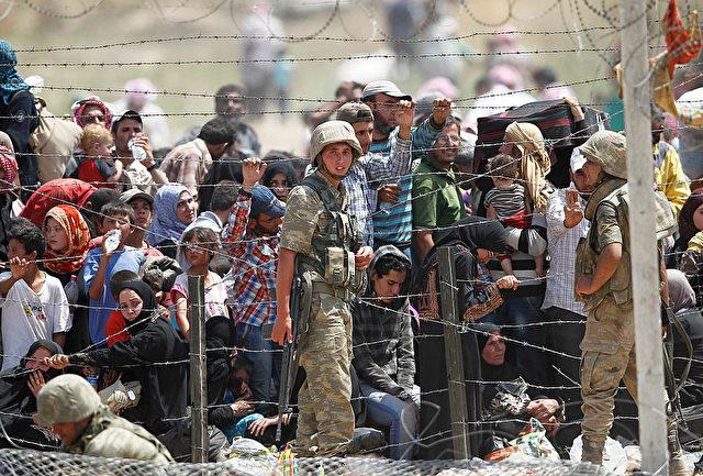 Flüchtlinge an der türkisch-syrischen Grenze. Foto: Gokhan Sahin/Getty Images