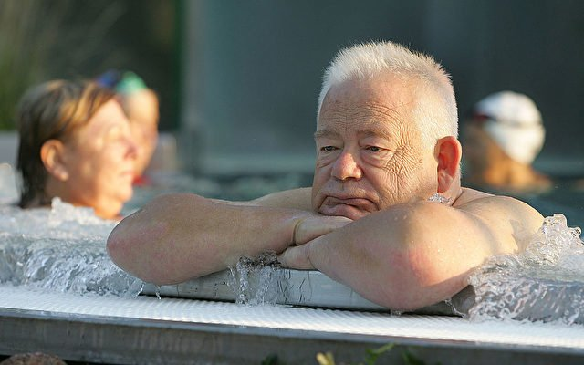RUESSELSHEIM, GERMANY - SEPTEMBER 03:  An elderly man sits in a public swimming pool on September 3, 2005 in Ruesselsheim, Germany. Germany's economy and pension system is being burdened by an expanding elderly population, and German politians are offering various solutions ahead of the elections on September 18.  (Photo by Ralph Orlowski/Getty Images)