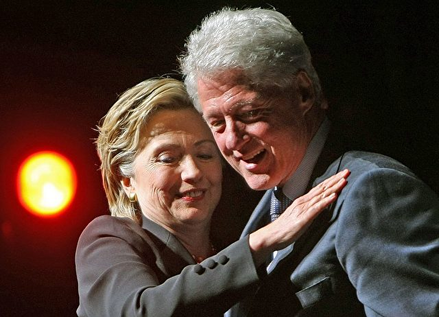 NEW YORK - OCTOBER 25:  Democratic presidential candidate and U.S. Sen. Hillary Rodham Clinton (D-NY), hugs husband and former President Bill Clinton as they appear at her 60th birthday party at Beacon Theater October 25, 2007 in New York City. The party and concert included celebrities Elvis Costello and Billy Crystal.  (Photo by Mario Tama/Getty Images)
