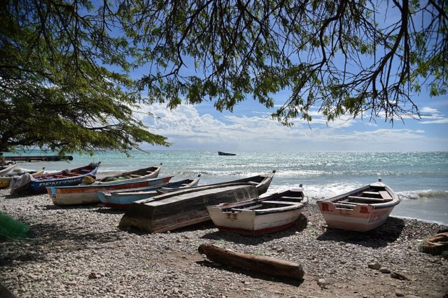 Boats are stored on a beach in the commune of is Anse-a-Pitres, in the South East Department of Haiti, on October 14, 2015. AFP PHOTO/HECTOR RETAMAL        (Photo credit should read HECTOR RETAMAL/AFP/Getty Images)