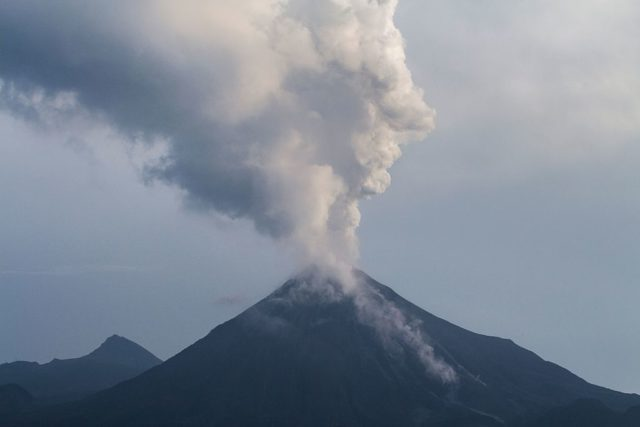 The Volcan de Fuego volcano spews ash and smoke on October 2, 2016 as seen from San Antonio, Colima State, Mexico. Mexican authorities have evacuated 400 people as a precaution as a major volcano spews lava, officials said. Authorities imposed a security perimeter of 12 km around the so-called Volcano of Fire in the western state of Colima. The state civil protection authority said lava had flowed one kilometer down from the crater, which soars to nearly 3,900 metres. / AFP / Hector GUERRERO        (Photo credit should read HECTOR GUERRERO/AFP/Getty Images)