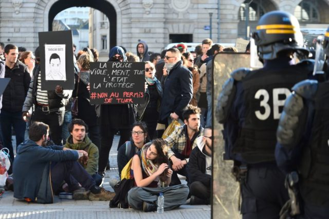 Protesters (L) face anti-riot police officers during a demonstration against police brutality on February 18, 2017 in Rennes, following the alleged rape in the Paris suburb of Aulnay-sous-Bois of a black youth, identified only as Theo, with a police baton, an incident that has sparked 10 nights of rioting and more than 200 arrests. The injuries sustained by Theo during a stop-and-search operation on February 2 in the suburb of Aulnay-sous-Bois have sparked clashes with police and arson attacks across the impoverished, ethnically-mixed housing estates that ring the French capital. One officer has been charged with rape and the three others with assault. All four have been suspended from the force. / AFP / JEAN-FRANCOIS MONIER (Photo credit should read JEAN-FRANCOIS MONIER/AFP/Getty Images)