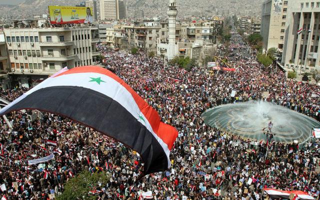 Pro-Regierungsdemonstration in Syrien, kurz vor Beginn des Krieges. 29. März 2011. Foto: ANWAR AMRO/AFP/Getty Images