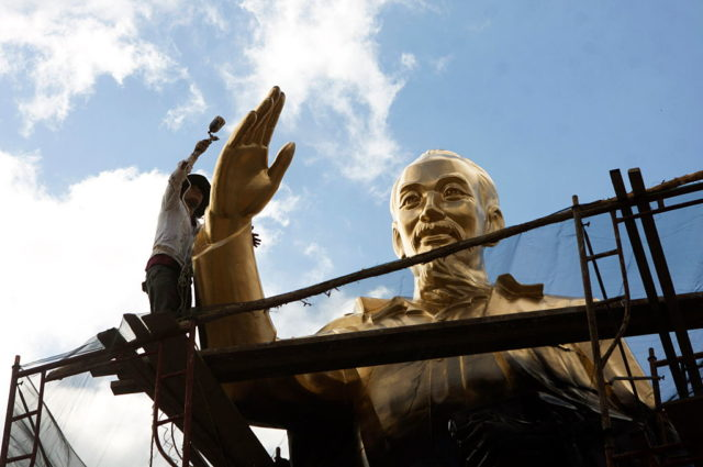 TOPSHOT - This picture taken on January 24, 2016 shows a worker repainting a large statue of the late president Ho Chi Minh, founder of today's communist Vietnam, at a public park in the southern city of Can Tho. Vietnam began a crucial political transition on January 21 as the five-yearly Communist Party congress convened to pick new leaders amid a bitter factional fight, the outcome of which could set the pace of key economic reforms. AFP PHOTO / AFP / STR        (Photo credit should read STR/AFP/Getty Images)