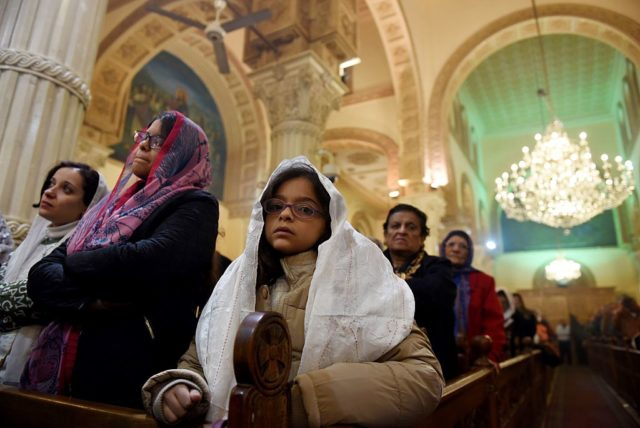 Orthodox Christians attend a Christmas eve mass at Virgin Mary Church in Road El Farag district, in Cairo on January 6, 2017 / AFP / MOHAMED EL-SHAHED        (Photo credit should read MOHAMED EL-SHAHED/AFP/Getty Images)
