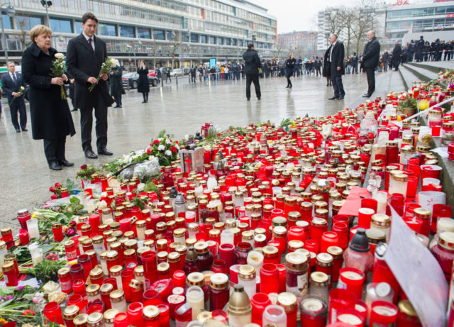 BERLIN, GERMANY - FEBRUARY 17: German Chancellor Angela Merkel and Canadian Prime Minister Justin Trudeau prepare to lay flowers at a memorial to the victims of the December Berlin terror attack at Breitscheidplatz on February 17, 2017 in Berlin, Germany. Canada's Prime Minister Justin Trudeau is visiting Germany for his first official visit after delivering a speech during a plenary session at the European Parliament in Strasbourg, France consisting of a pro-trade pitch to a conflicted Europe. On December 19 Anis Amri, a Tunisian man who had sought asylum in Germany, drove a truck into the crowded Christmas market at Breitscheidplatz and killed 12 people. (Photo by Steffi Loos/Getty Images)