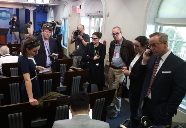 WASHINGTON, DC - FEBRUARY 24: Reporters in the Brady Briefing Room listen to a tape from a press gaggle by White House Press Secretary Sean Spicer, on February 24, 2017 in Washington, DC. The New York Times, Los Angeles Times, CNN and Politico were also excluded from the off camera gaggle. (Photo by Mark Wilson/Getty Images)