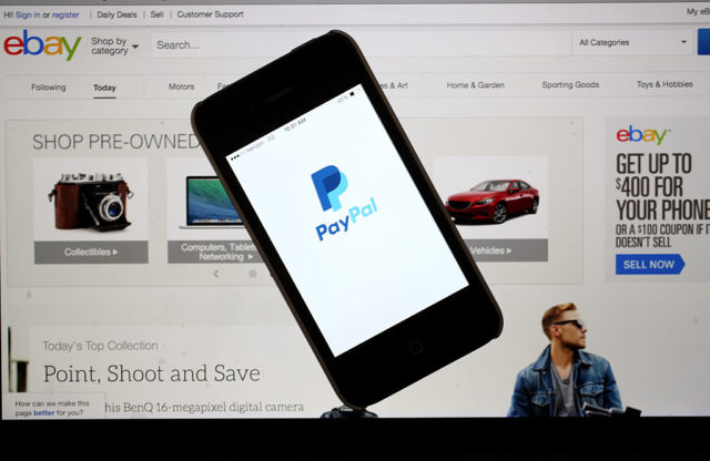 MIAMI, FL - SEPTEMBER 30: In this photo illustration, an eBay website is seen on a computer screen and the PayPal website is seen on an iphone on September 30, 2014 in Miami, Florida. Today, eBay announced it will split from the payments service PayPal, forming two independently traded companies beginning in 2015. (Photo by Joe Raedle/Getty Images)