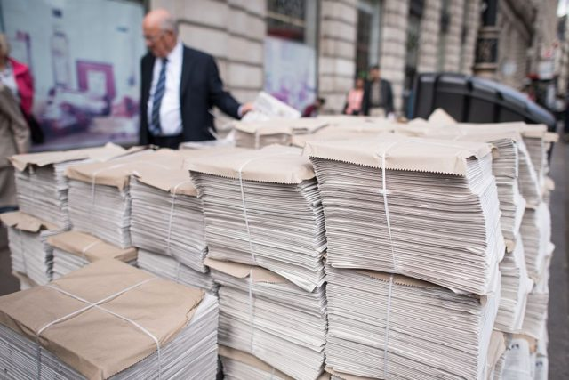 A stack of free newspapers are shown in a central London street.  AFP PHOTO / LEON NEAL        (Photo credit should read LEON NEAL/AFP/Getty Images)
