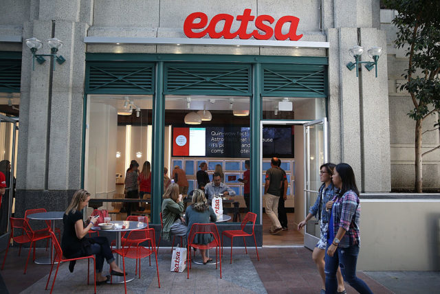 "SAN FRANCISCO, CA - AUGUST 31: People walk by eatsa, a fully automated fast food restaurant on August 31, 2015 in San Francisco, California. eatsa, an automated fast food restaurant that has no servers, wait staff and a virtual cashier that offers fresh quinoa bowls opened in San Francisco's Financial District. Customers place their orders at an interactive kiosk and then pick their orders at a first of its kind automated food pick-up system that features a collection of glass door ""cubbies"" with a door that displays personalized graphics and presents the food at the touch of a button. (Photo by Justin Sullivan/Getty Images)"