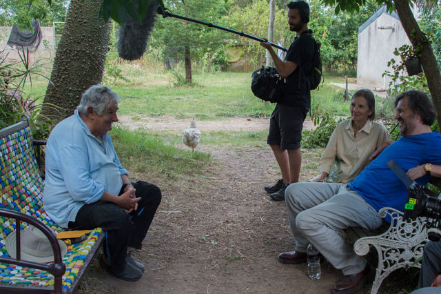 Uruguayan former President and guerrillas Jose Mujica (L) speaks during the shooting of an interview by director Emir Kusturica (R) at Mujica's home in Montevideo on December 12, 2016. Kusturica is shooting the last scenes of his documentary about Mujica. / AFP / Pablo PORCIUNCULA (Photo credit should read PABLO PORCIUNCULA/AFP/Getty Images)