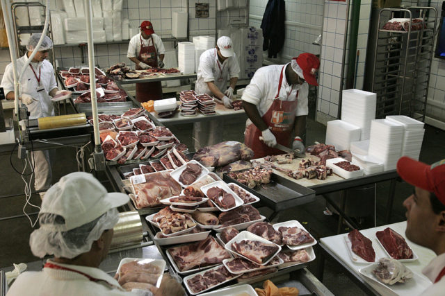 Sao Paulo, BRAZIL: Employees prepare pieces of beef at a supermarket, in Sao Paulo, Brazil, 30 May 2007. The Brazilian group JBS-Friboi, Latin America's main producer and exporter of bovine meat, announced the acquisition of the American company Swift Foods by 1,400 million dollars, giving rise to the birth of a giant of the branch. Brazil has the world's biggest flock, with near 200 million heads, according to the minister of Agriculture, and has become the first world-wide exporter in the last years, surpassing to the United States and Australia. AFP PHOTO/Mauricio LIMA (Photo credit should read MAURICIO LIMA/AFP/Getty Images)