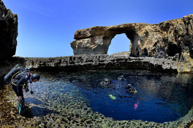 DWEJRA, GOZO - MAY 20:  Divers are seen in front of the natural arch 'The Azure Window' at Dwejra Bay on May 20, 2014 in Dwejra/Gozo, Malta.  (Photo by Sascha Steinbach/Getty Images)
