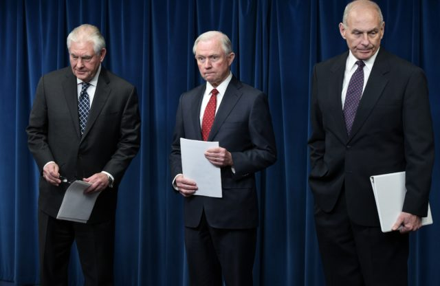 "TOPSHOT - (L-R) US Secretary of State Rex Tillerson, Attorney General Jeff Sessions, and Homeland Security Secretary John Kelly arrive to deliver remarks on visa travel at the US Customs and Border Protection Press Room in the Reagan Building on March 6, 2017 in Washington, DC. US President Donald Trump signed a revised ban on travelers from six Muslim-majority nations Monday -- one with a reduced scope so Iraqis and permanent US residents are exempt. The White House said Trump signed the order -- which temporarily freezes new visas for Syrians, Iranians, Libyans, Somalis, Yemenis and Sudanese citizens -- behind closed doors ""this morning"".  / AFP PHOTO / MANDEL NGAN        (Photo credit should read MANDEL NGAN/AFP/Getty Images)"