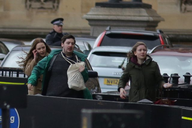 People leave after being evacuated from the Houses of Parliament in central London on March 22, 2017 during an emergency incident. Britain's Houses of Parliament were in lockdown on Wednesday after staff said they heard shots fired, triggering a security alert. / AFP PHOTO / DANIEL LEAL-OLIVAS (Photo credit should read DANIEL LEAL-OLIVAS/AFP/Getty Images)