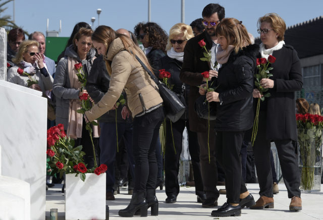 Relatives of the victims of the Germanwings crash display flowers in front of the commemorative plaque set for the victims of the Germanwings plane which crashed into the French Alps and claimed 150 lives, at Barcelona's airport, in El Prat de Llobregat on March 23, 2017. The father of a Germanwings co-pilot whose plane slammed into the Alps in 2015 is trying to prove his son did not crash the jet deliberately, sparking anger among victims' families. The crash killed all 144 passengers and six crew -- a group of people from 20 countries, among them 72 Germans and 50 Spaniards, heading back from Barcelona and bound for Duesseldorf airport. / AFP PHOTO / LLUIS GENE (Photo credit should read LLUIS GENE/AFP/Getty Images)