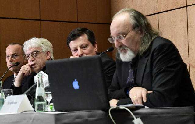 (L-R) Guenter Lubitz, father of Andreas Lubitz, a co-pilot who crashed the Germanwings flight two years ago, killing 150 people in the French Alps, spokesman Hans-Joachim Ruedel, lawyer for media affairs Andreas Behr, journalist specialized in civil aviation Tim van Beveren attend a press conference in Berlin, on March 24, 2017. The father of a Germanwings co-pilot is trying to prove his son did not crash the jet deliberately, sparking anger among victims' families. / AFP PHOTO / Tobias SCHWARZ (Photo credit should read TOBIAS SCHWARZ/AFP/Getty Images)