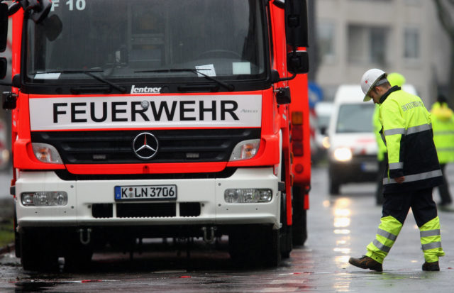 COLOGNE, GERMANY - MARCH 06:  A fireman waits next to his car during the clean up the ruine of the building of the Historical Archive of the City of Cologne on March 6, 2009 in Cologne, Germany. Cologne's six-story city archive building groaned then collapsed in a pile of rubble Tuesday earlier this week as people inside fled in panic. The archive building collapsed about 2 p.m., ripping open and dragging down parts of two adjacent buildings that contained apartments and an amusement arcade. Two people are still missing. Unofficial voices make responsible the works in process on a new underground 'Nord-Sued' line which is passing by right under the collapsed building. Cologne has archive material going back over centuries, including manuscripts by communist pioneers Karl Marx and Friedrich Engels and documents related to German writer Heinrich Boell.  (Photo by Vladimir Rys/Getty Images)