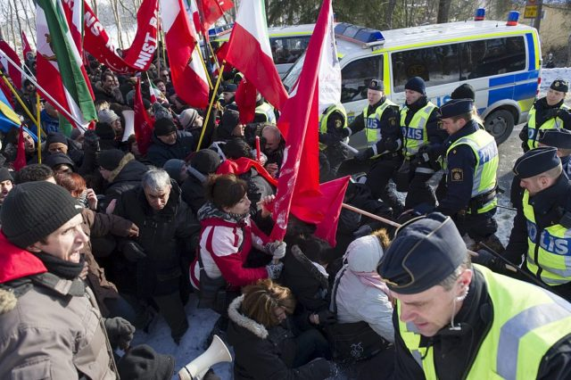 Swedish police try to contain demonstrators outside the Iranian Embassy in Stockholm on February 11, 2010. Iran's President Mahmoud Ahmadinejad boasted Iran was now a nuclear nation as he announced today the production of its first highly enriched uranium on the anniversary of the 1979 Islamic revolution. AFP PHOTO / Henrik Montgomery / SCANPIX /   (Photo credit should read HENRIK MONTGOMERY/AFP/Getty Images)