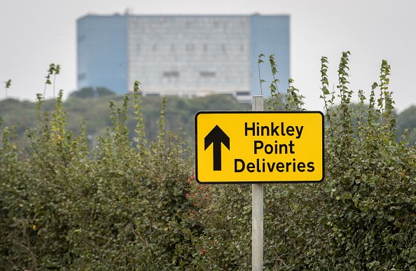 BRIDGWATER, UNITED KINGDOM - SEPTEMBER 20:  A sign directing construction traffic to the new site of the new Hinkley Point  power station is seen in front of the old Hinkley Point A buildings near Bridgwater on September 20, 2016 in Somerset, England. The decision last week by the Prime Minister Theresa May to finally give the go-ahead to the much delayed project to construct a new nuclear power station at Hinkley Point next to the existing one, has been generally warmly welcomed by many people in the nearby town of Bridgwater, who hope that the decade-long construction period will bring a host of economic benefits to the area.  (Photo by Matt Cardy/Getty Images)