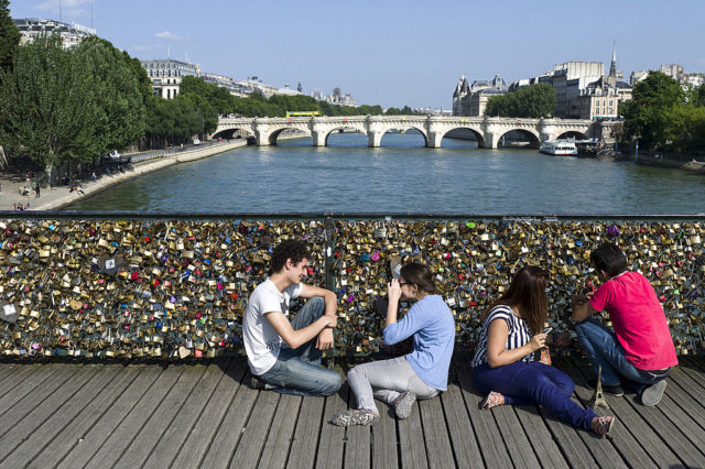 "People gather at the ""Pont des Arts"" bridge on July 5, 2013 in Paris. AFP PHOTO / FRED DUFOUR (Photo credit should read FRED DUFOUR/AFP/Getty Images)"