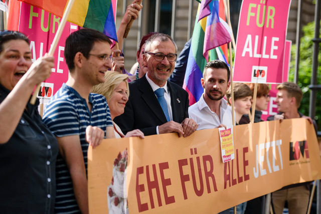 BERLIN, GERMANY - JUNE 12:  Volker Beck, Member of German Greens Party (4th from L) demonstrates with activists with the Lesbian and Gay Association of Berlin demonstrate outside the Bundesrat, Germany's Federal Council, where members were scheduled to debate the legalization of gay marriage on June 12, 2015 in Berlin, Germany. Specifically, the activists were urging Berlin Mayor Michael Mueller to confirm his position for legalization in the city-state of Berlin, against possible opposition from the German Christian Democrats (CDU). Though Germany recognizes a privileged partnership for homosexual couples it does not allow marriage with the same rights as for heterosexuals.  (Photo by Clemens Bilan/Getty Images)