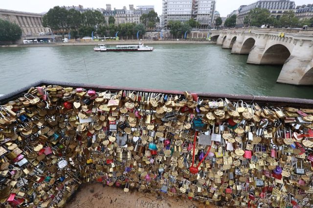 "Love-locks are seen on the bridge of Pont Neuf in Paris, on August 4, 2016. Love may know no bounds, but Paris intends to instill some: authorities are going to take a tougher line with swooning couples attaching ""love-locks"" to city bridges as a sign of their undying devotion. In June last year authorities removed hundreds of thousands of such padlocks from the city bridges, notably the Pont des Arts which had a section collapse under the weight of the locks. / AFP / JACQUES DEMARTHON (Photo credit should read JACQUES DEMARTHON/AFP/Getty Images)"