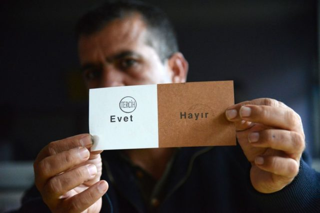 An electoral staff member shows a ballot during the counting process after polls closed in Turkey's tightly-contested referendum on expanding the powers of the president on April 16, 2017 in Diyarbakir, seen as a crossroads in the modern history of the country.  Turkey was voting to decide whether to expand the president's powers in a bitterly-contested referendum set to determine the future course of the key NATO member and EU hopeful.  / AFP PHOTO / ILYAS AKENGIN        (Photo credit should read ILYAS AKENGIN/AFP/Getty Images)